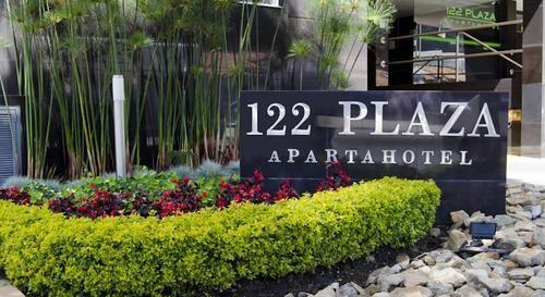 122-plaza-aparthotel-kolumbia-ogrod.jpg